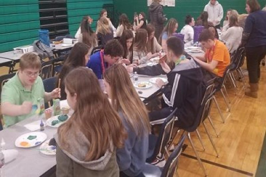 OPERATION SMILE CLUB and Beach Buddies Club meet up to eat pizza and make crafts in the school's gym this week. The two organizations are teamed together to plan the first ever Buddies Helping Buddies Leadership Workshop on Saturday, March 2 .