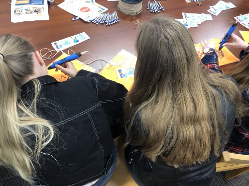 GERMAN STUDENTS USE 3-D pens to create a souvenir. The exchange students left mid april to return to Germany.