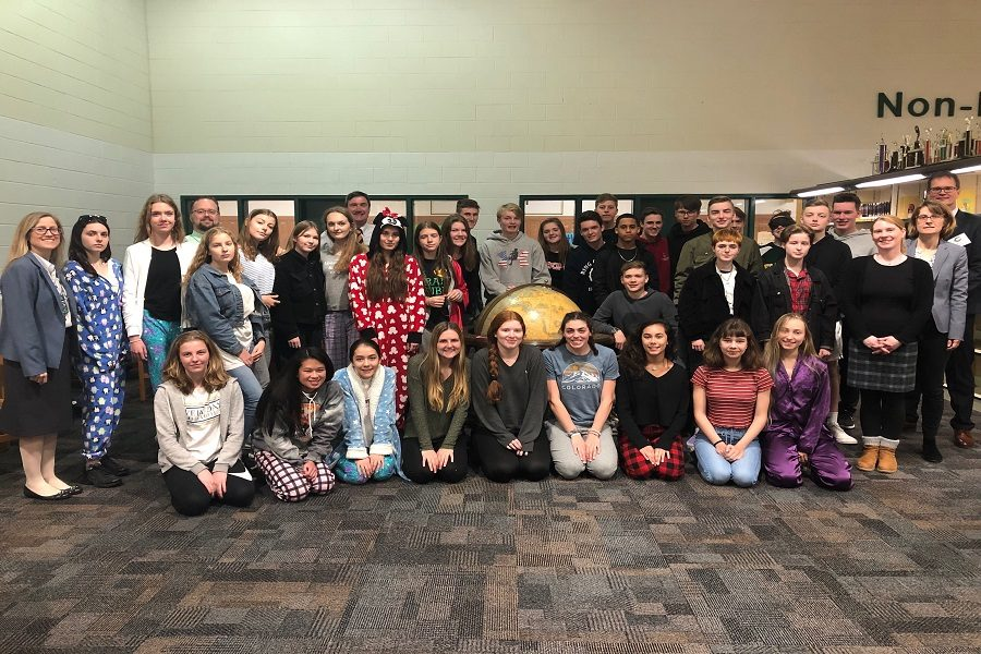 GERMAN STUDENTS STAND together after watching a presentation given by both Dr. Kelly and their principal Peter Schey. Both student bodies also attended a dinner at Steinhilber's Restaurant to meet both principals personally.