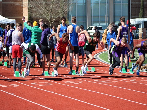 FALCON SPRINTERS MIKE Thompson and Reece Sheppard start the 100m dash.  The track team began their season at Norfolk Academy on March 23.