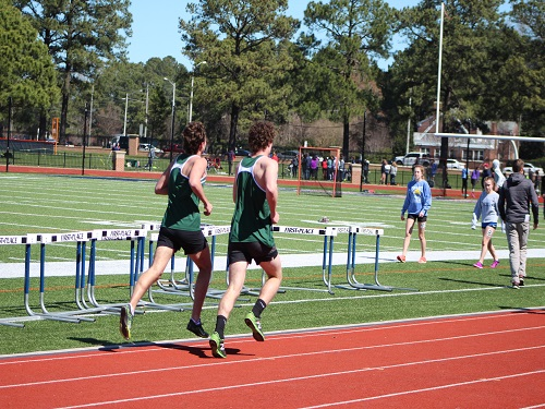 SENIORS+REESE+SMITH+and+Nick+Elfelt+finish+the+last+stretch+of+the+1600m+run.++The+Falcon+runners+had+their+first+regular+season+meet+in+early+April.