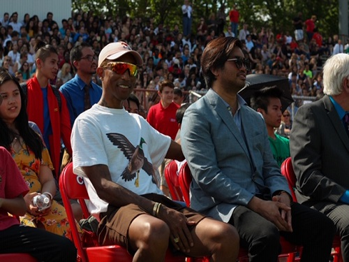 CELEBRITIES PHARRELL WILLIAMS and Chad Hugo watch the Battle of the Bands in the Princess Anne High School Stadium on Wednesday, April 24. The band programs from all Virginia Beach schools were given the opportunity to preform.