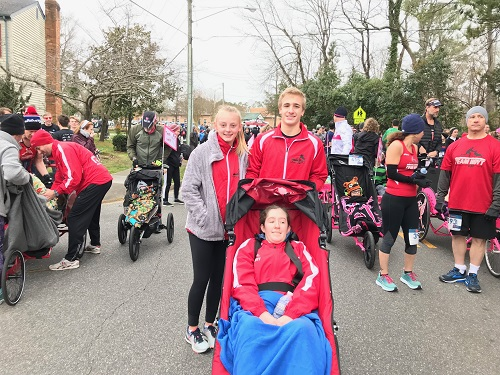 TEAM HOYT MEMBERS Katie White and sophomores Gresham Wall and Morgan Mckinley prepare for the Love Run. Team Hoyt ran in their first race with the school's chapter.