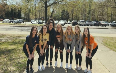 SENIORS KATIE BRUNS, Sara Dixon, Maddie Butkovich, Cayla Katz, Anna Mason, Madison Herron and Ashley Brunick pose for a picture on the last school day before spring break. The girls showed off their college shirts that represented where they will be attending in the Fall.