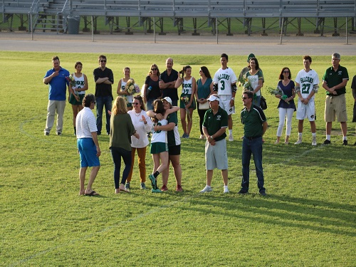 FALCON LACROSSE PLAYERS celebrate with parents.  Faculty, family, and friends joined the players in their senior night ceremony on Friday, May 3.