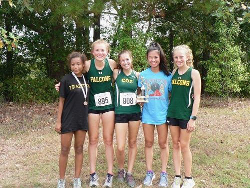 FALCON GIRLS' VARSITY team celebrates runner up. The team finished within the top twenty-five.