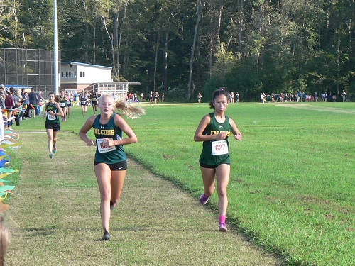 JUNIOR MORGAN MCKINLEY and senior Bailey Deaver lead the chase pack. Both fiished in the top ten of the race.