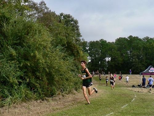 JUNIOR JACOB WALL turns the corner to the last stretch. Wall was one of the Falcon frontrunners in the race.