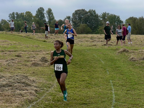 FRESHMAN SALYA BROWN runs down the hill. Brown finished in the top ten of the A race.
