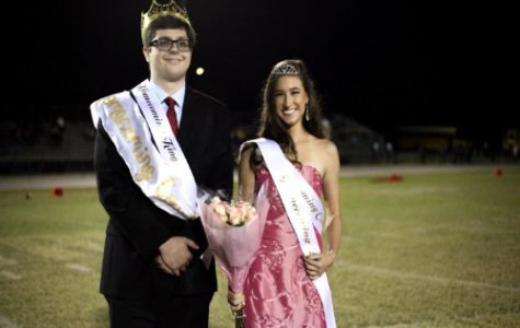 HOMECOMING KING AND queen seniors Will Jutton and Jordan Parker-Ashe receive their crowns at the Homecoming Football game. After, they were crowned, the new king and queen took a victory lap around the track.