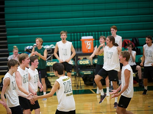 BOYS VOLLEYBALL CELEBRATES a hard fought victory over Princess Anne High School earlier this week. This victory solidiefies a top ranking in the 5A conference.