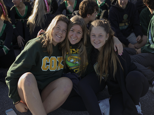 JUNIORS PEYTON LONG (left), Hannah Gilden, and Hayden Miller represent water polo team at pep rally. Long is team captain while Gilden and Miller are team players.