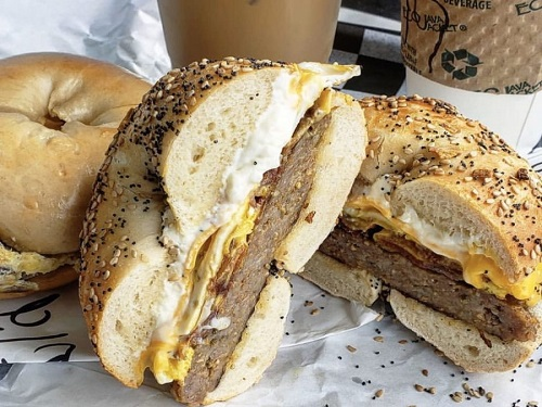 LOCAL REGULARS DEVOUR a classic sausage, egg, and cheese on an everything bagel at Bagel Baker. Bagel Baker has become a staple in high school students' morning routines since its opening in 2012.