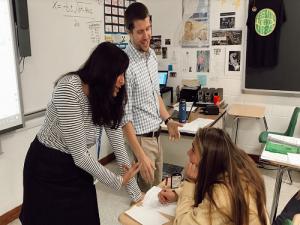 VTFT TEACHER JENNIFER Nardelli and math teacher Sean Duffy guide junior Natalie Jones through her math homework. Jones showed her excitement in anticipation of Duffy co-teaching the class next year.