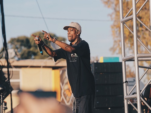 RAPPER TRAVIS SCOTT points to his audience during a concert.
