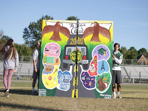 SCA STUDENTS PRESENT the senior mural during the fall pep rally.  The mural reflected the seniors' experiences at CHS.