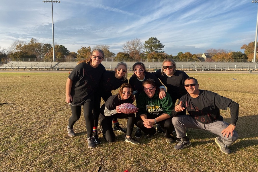 THE TEACHERS TAKE home the coveted bling ball after winning the 2019 Powder Puff tournament last Thursday. The game was decided by a single touchdown that pushed The Black Widows to a first place victory.