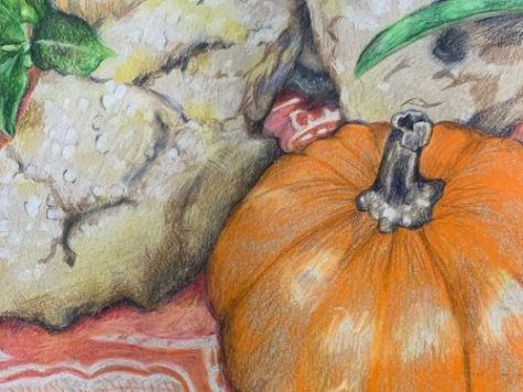 ART STUDENTS DRAW sill-life colored pencil renditions of the foods created by the Catering class. Students in both classes were able to merge their artistic talents using different styles of art.