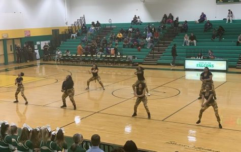 FALCONS STEP TEAM amps up the crowd with their routine. They performed during halftime on Tuesday's varsity basketball game.