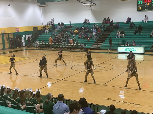 FALCONS STEP TEAM amps up the crowd with their routine. They performed during halftime on Tuesdays varsity basketball game.