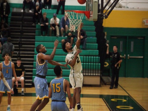 SENIOR DARRIEN PRATT makes a layup against First Colonial. The game was won in the last 20 seconds with a final free throw..