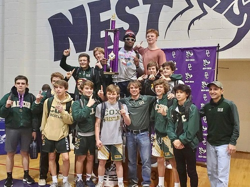 FALCON WRESTLING CELEBRATES their win at the Hornet Holiday tournament last weekend. The team is off to a great start and looking forward to a winning season.