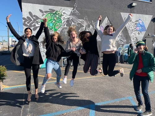 ART FOUNDATION STUDENTS jump for joy while visiting the Museum Of Contemporary Art and Virginia Beach's own VIBE district. Students were able to collaborate with professional artists and learn about the many different art forms in order to create their own art work on this field trip.