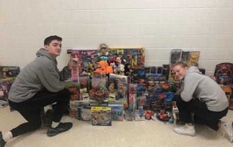 SOPHOMORES WILL BONDE and Abby Spear organize toys collected by the schools's Noble Teens organization.  All toys will be distributed to children in need for the holidays.