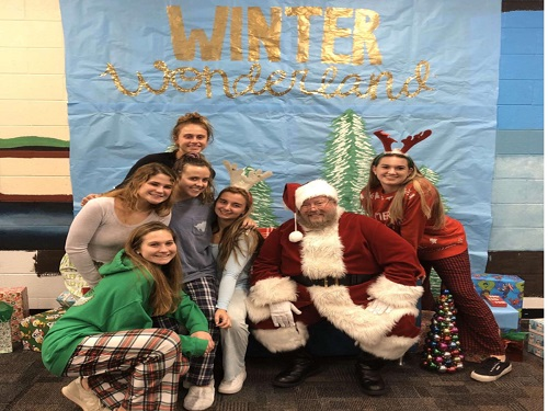 STUDENTS GET TOGETHER and set up the annual 'Parents Night Out' to raise money for the school. The goal is to give parents the chance to go holiday shopping while the students babysit their kids.