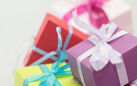 COLORFUL HOLIDAY GIFTS are arranged in a pile. They were do it yourself presents made for family members.