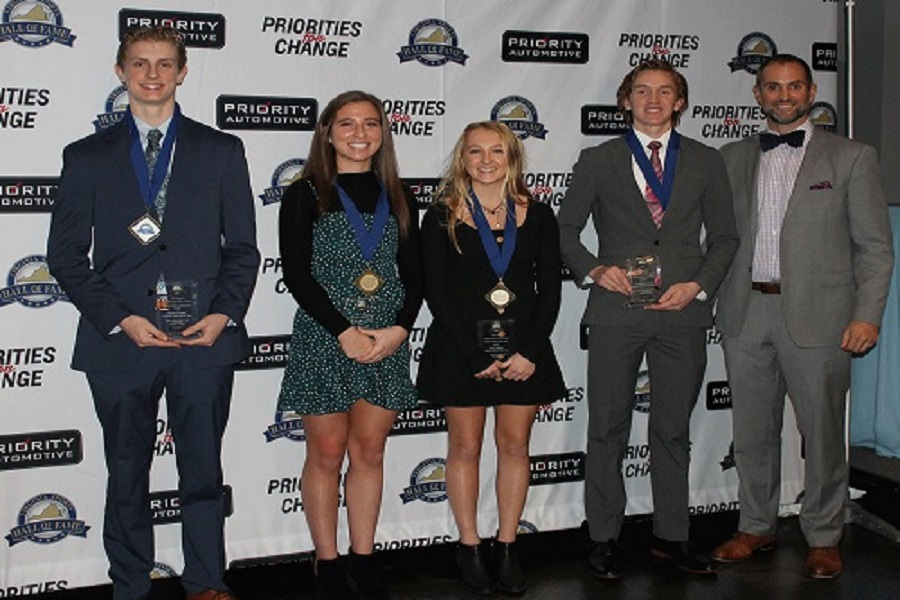 FOUR OUTSTANDING STUDENT-athletes including two of the school's state winning field hockey players (center) receive awards as the newest inductees into the Virginia Sports Hall of Fame on Sunday. Seniors Kylie Levine and Zoe Campisi (center) are the newest inductees.