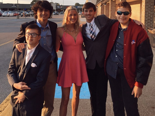 PRESIDENT CAROLINE HOLLAND (center) and board member Will Katabian attend the Homecoming Dance with the buddies last October. Due to the grant, the club will be able to participate in more interactive events, rather than simply attend events put on by other clubs within the school and community.