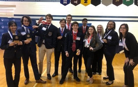 DECA STUDENTS SHOW off the 'bling' they brought home to the Nest from the most recent district competition held at Virginia Wesleyan University. Thirty-eight students attended and 20 of them earned a medal for various entrepreneurial skills.