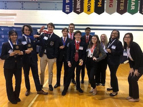 DECA competitors take on districts, individuals and teams qualify for state competition