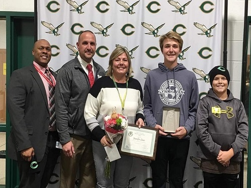 NEW FALCON TEACHER of the Year Guidance Counselor Jenn Lanz (center) smiles ear to ear after learning she was chosen by colleagues to represent the school as the most outstanding teacher.  Lanz stands with Head Guidance Director for VB Schools (left) Bobby Jamison, her husband and two boys after accepting the prestigious award.
