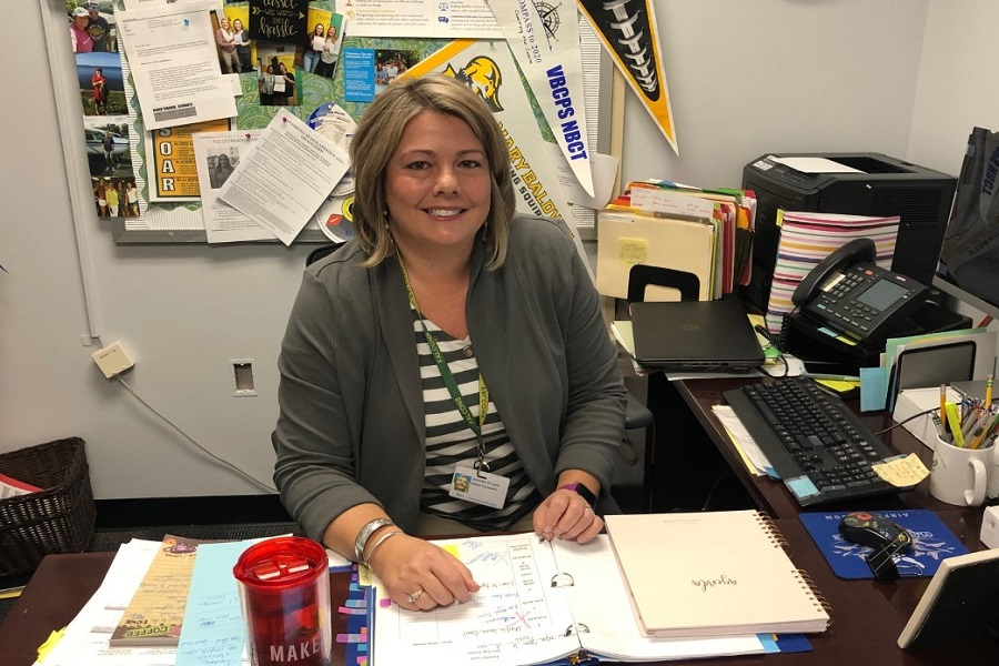 TEACHER OF THE Year and Guidance Counselor Jenn Lanz takes a moment out of her busy day to smile for the camera.