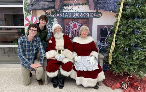 SENIOR DANIEL ELFELT happily tells Santa what he wants for Christmas. According to Elfelt, he asked Santa to bring back the Latin Club.