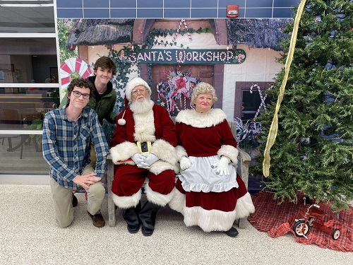 SENIOR DANIEL ELFELT happily tells Santa what he wants for Christmas. According to Elfelt, he asked Santa to bring back the Latin Club.