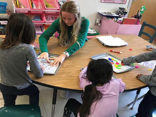 SENIOR EMMA LEWIS enjoys helping her kindergarten students while learning the value of impacting young minds. She has recently made the decision to pursue a career in elementary education in college in the fall.