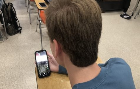 SENIOR ERIC MICHALS watches TikTok's on his