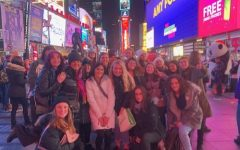 New York City's Times Square plays host to museums, galleries and theaters, as well as the opportunity to see the bright neon lights at night. Art teacher Mrs. Van Veenhuyzen (center) and her students surround themselves in the city's diverse culture.