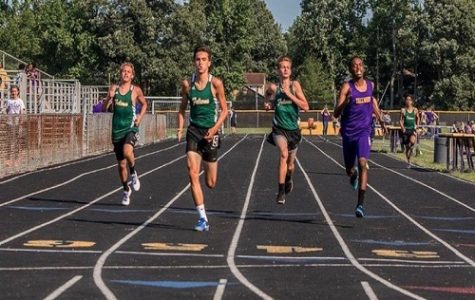 SENIOR JOSH WARMERS (middle left) competes in a track meet against Tallwood High School. He claimed his motivation for running was his mother.