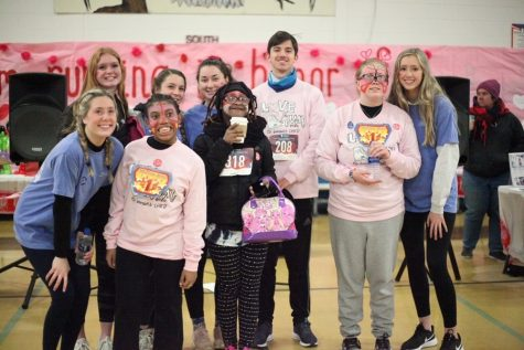 STUDENTS INVOLVED WITH Beach Buddies gather together to participate in the Love Run event. The goal was to raise money to benefit the children of CHKD and bring smiles to their faces.