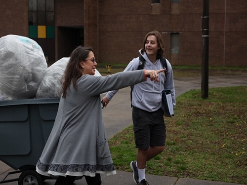 SENIOR KONRAD FREISCHLAG pulls a cart of recycled items to be transported to a recycling center. This was the first round of drop-offs for the school in the NexTrex Recycling Challenge.