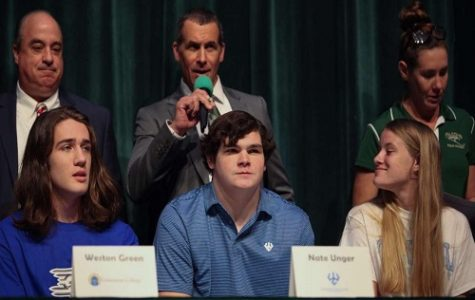 SENIOR NATE UNGER (center front) sits stoically while his football coach Bill Stachelski (center back) speaks about his work ethic and character during National Signing Day. Unger ultimately chose to venture into higher education. for both academics and football. at Washington & Lee University in the fall.