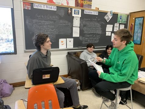 SENIORS TANNER BAILEY (right) and Finley Legg model the way professionals will speak to students at the Mock Interview. Bailey explained to Legg that students must sign up by Friday, March 6.