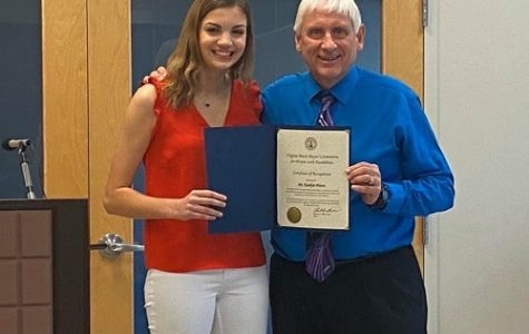 SENIOR KAITLYN PISTON receives the Mayor's Committee for Persons with Disabilities award from Mayor Bobby Dyer. Piston showed great leadership skills and determination when planning the workshop.