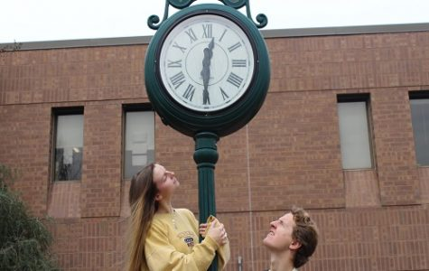 SENIORS ADAM TUCKER (left) and Rhyan Moran squint at the clock ouside school as they were voted most likely to be late to graduation. Now, no one is sure when the senior graduation might be, much less what time it will be held.