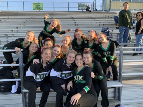COQUETTE DANCE TEAM prepares for a halftime performance in 2019 before the pandemic.  The team will show their award winning kick dance.