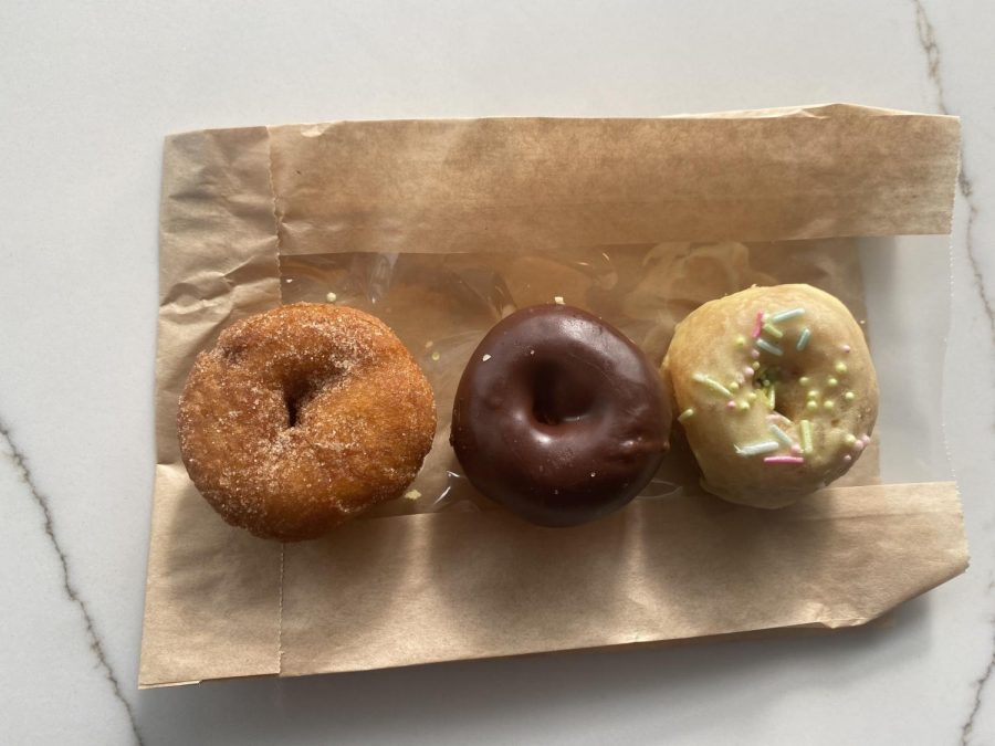 THE THREE DONUTS sit still on the napkin, seemingly waiting to be devoured. The tasty treats were eaten just moments after taking the picture.